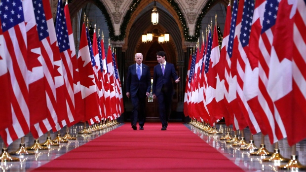 Prime Minister Justin Trudeau and US vice-president Joe Biden walk down the Hall of Honour on Parliament Hill in Ottawa - THE CANADIAN PRESS/Patrick Doyle